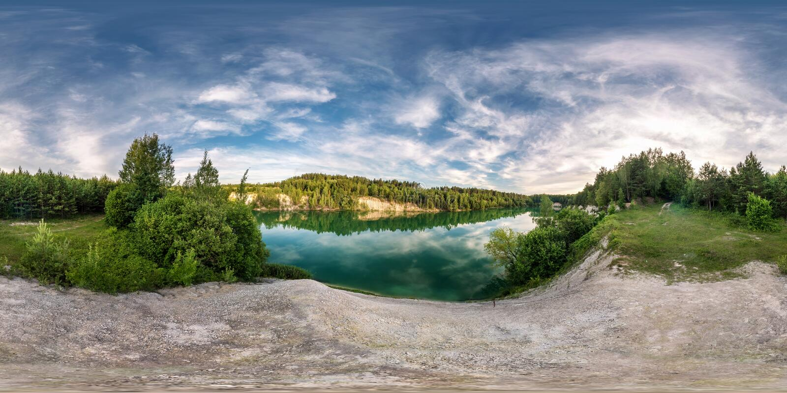 Full seamless spherical hdri panorama 360 degrees angle view on limestone coast of huge green lake or river near forest in summer stock image