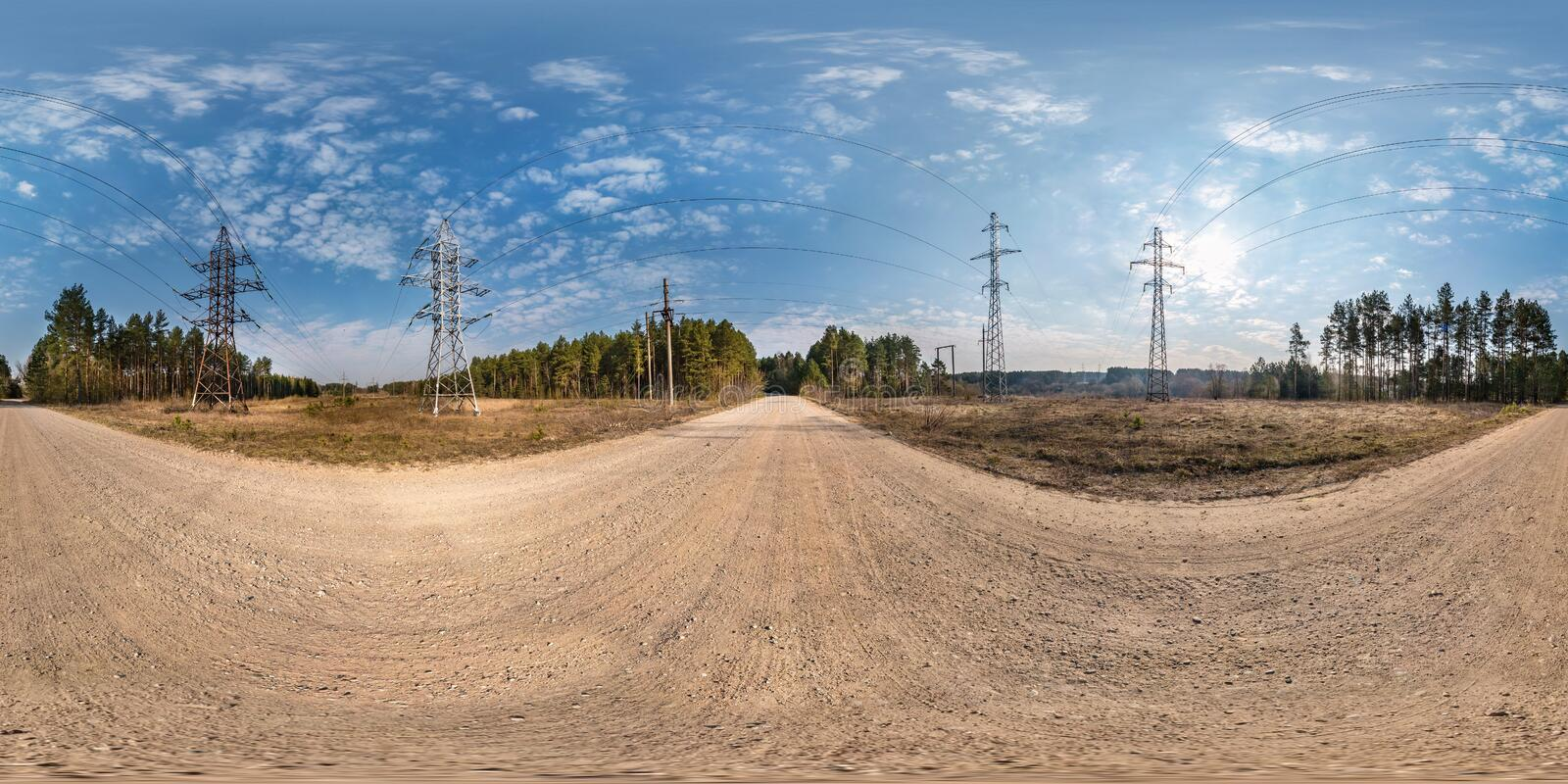 Full seamless spherical hdri panorama 360 degrees angle view near high voltage electric pylon towers on gravel road in royalty free stock images