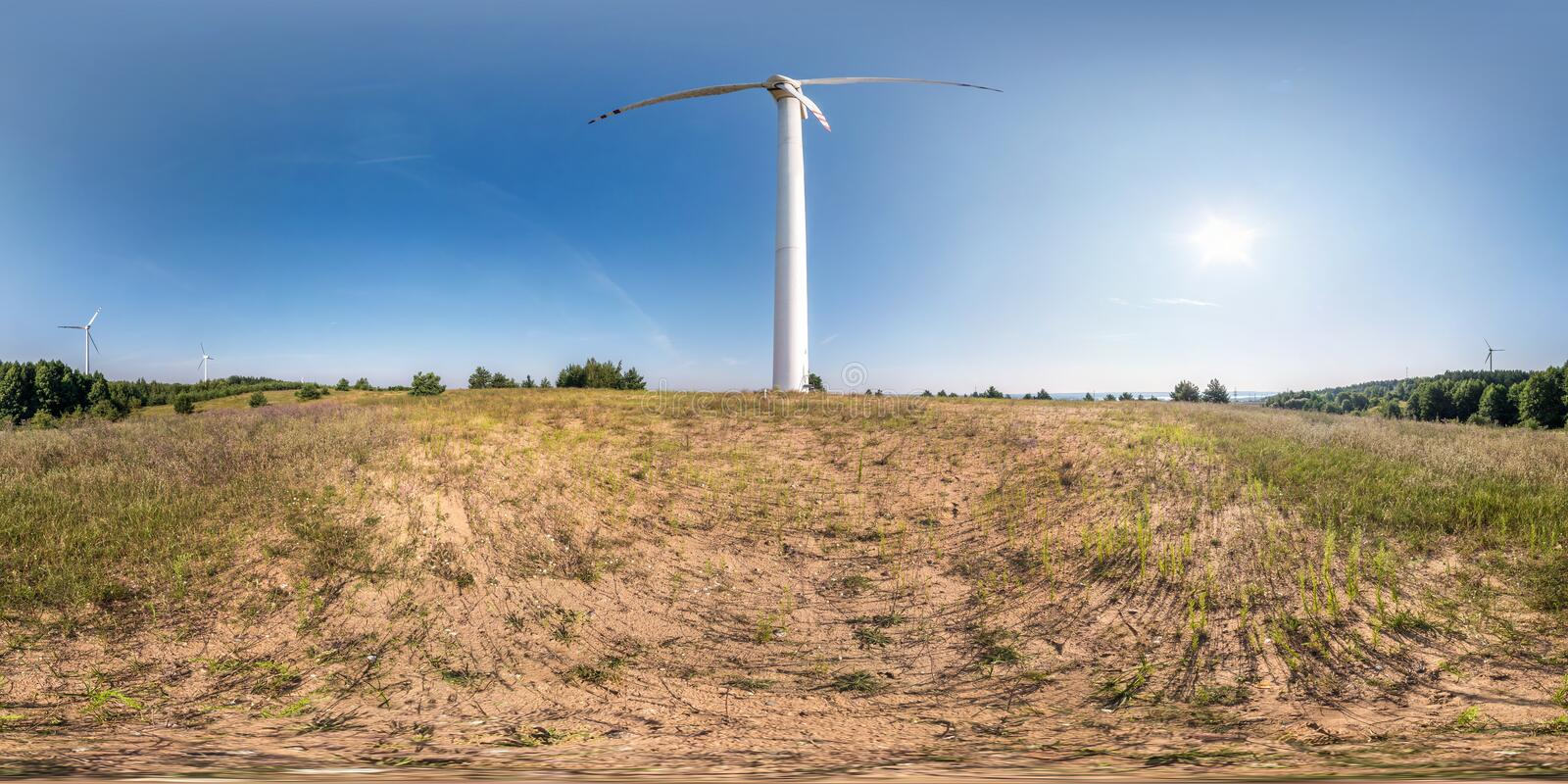 Full seamless spherical hdri panorama 360 degrees angle view near huge windmill propeller in equirectangular projection, VR AR. Virtual reality content. Wind royalty free stock image