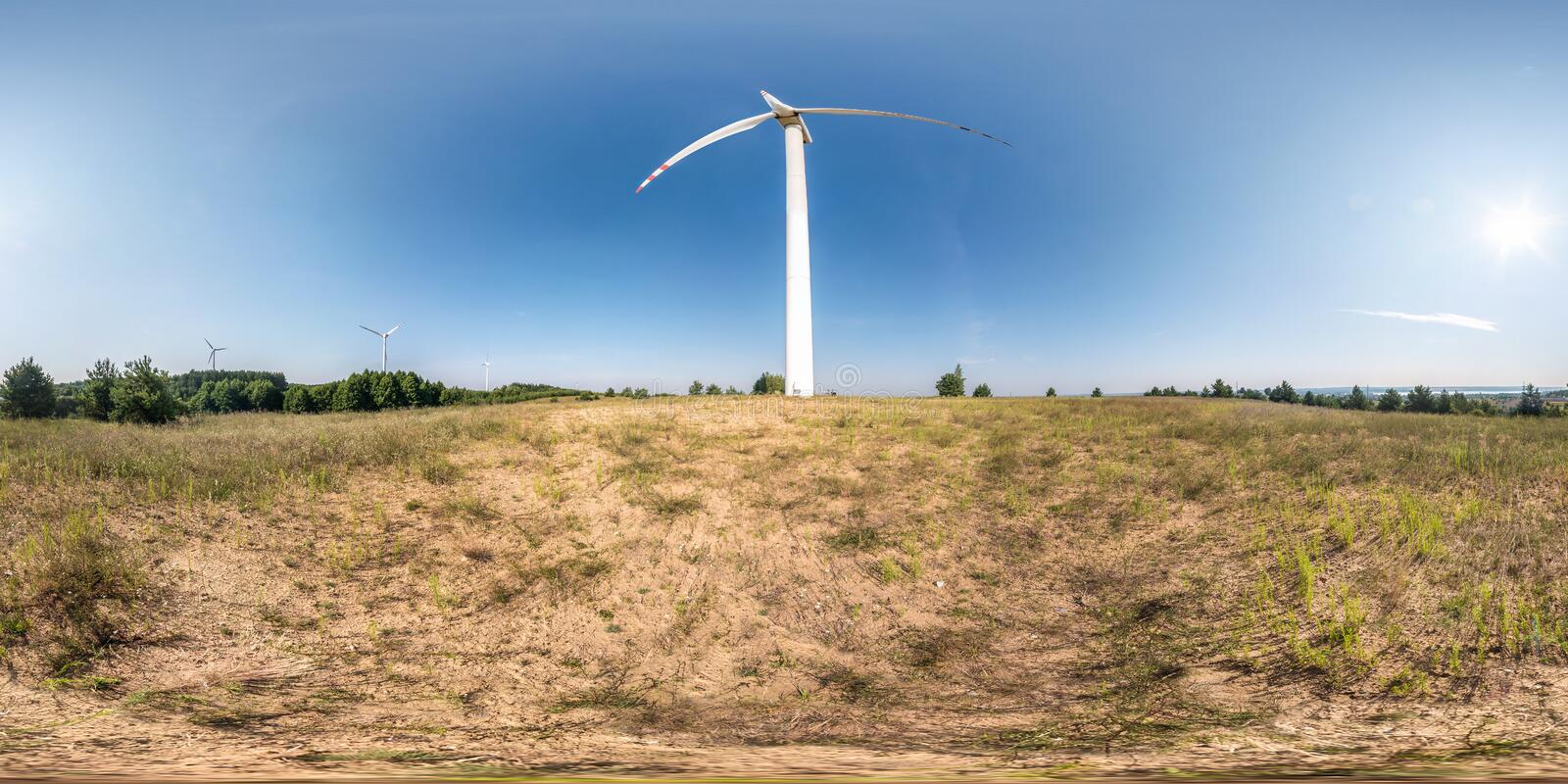 Full seamless spherical hdri panorama 360 degrees angle view near huge windmill propeller in equirectangular projection, VR AR. Virtual reality content. Wind stock photo