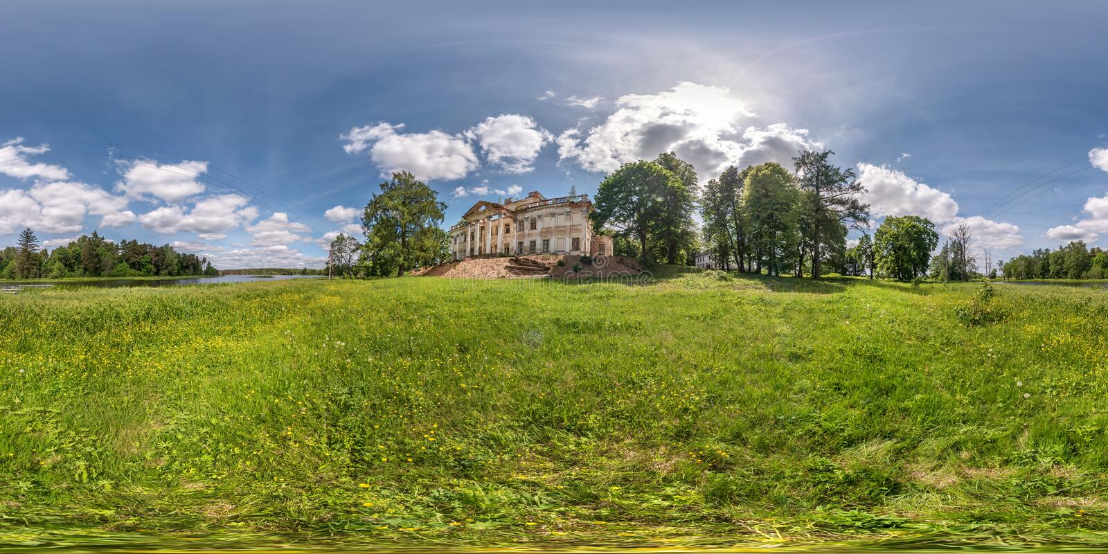 Full seamless spherical hdri panorama 360 degrees angle view near stone abandoned ruined palace and park complex in. Equirectangular projection, VR AR virtual royalty free stock image