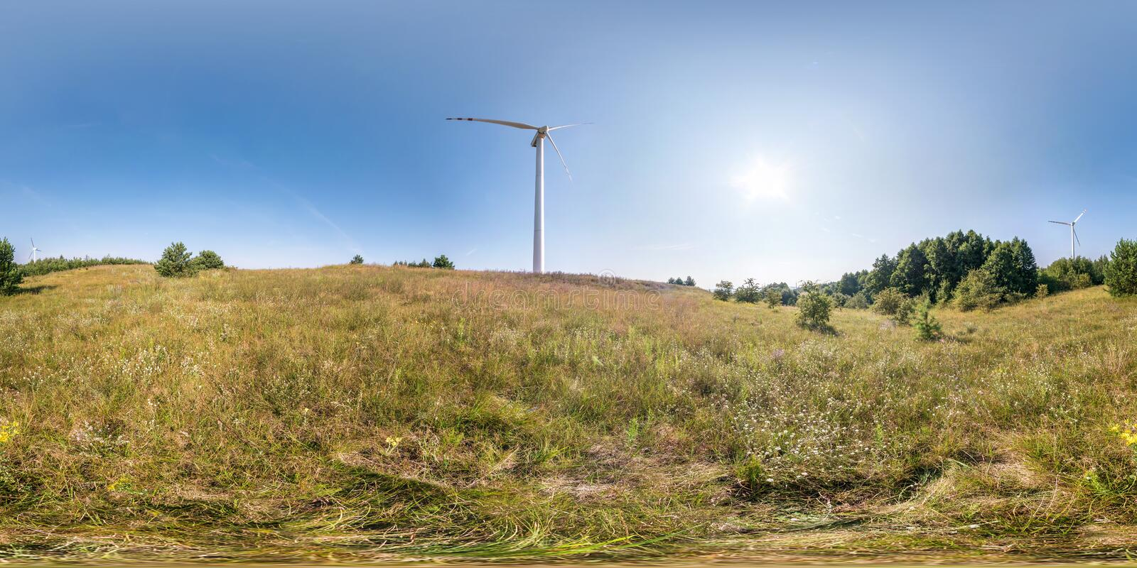 Full seamless spherical hdri panorama 360 degrees angle view near windmill propeller in equirectangular projection, VR AR virtual. Reality content. Wind power royalty free stock photos