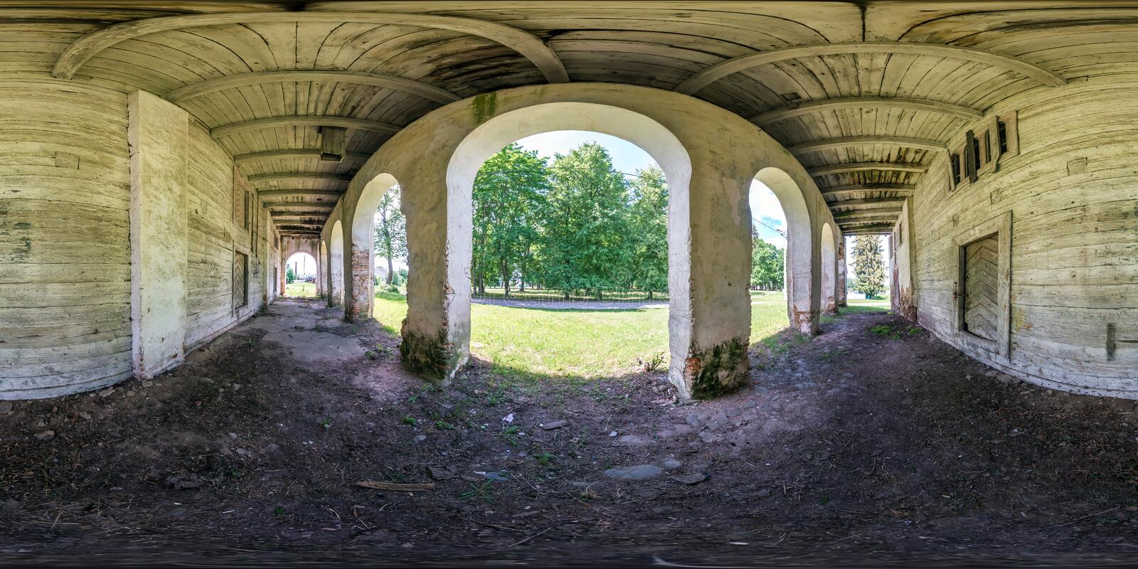 Full seamless spherical hdri panorama 360 degrees angle view near wooden abandoned ruined farm barn building with columns in stock photos