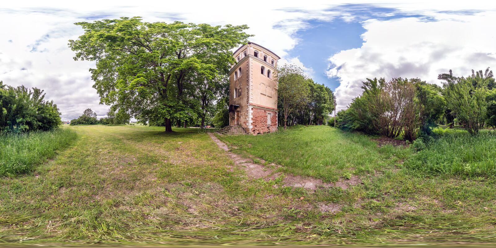 Full seamless spherical hdri panorama 360 degrees angle view on old stone abandoned fire tower in village park in equirectangular stock photography