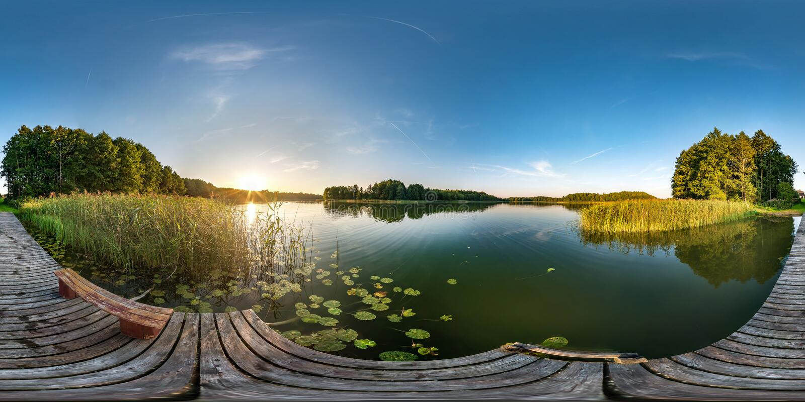 Full seamless spherical hdri panorama 360 degrees angle view on wooden pier near lake in evening in equirectangular projection. With zenith, ready VR AR virtual royalty free stock photo