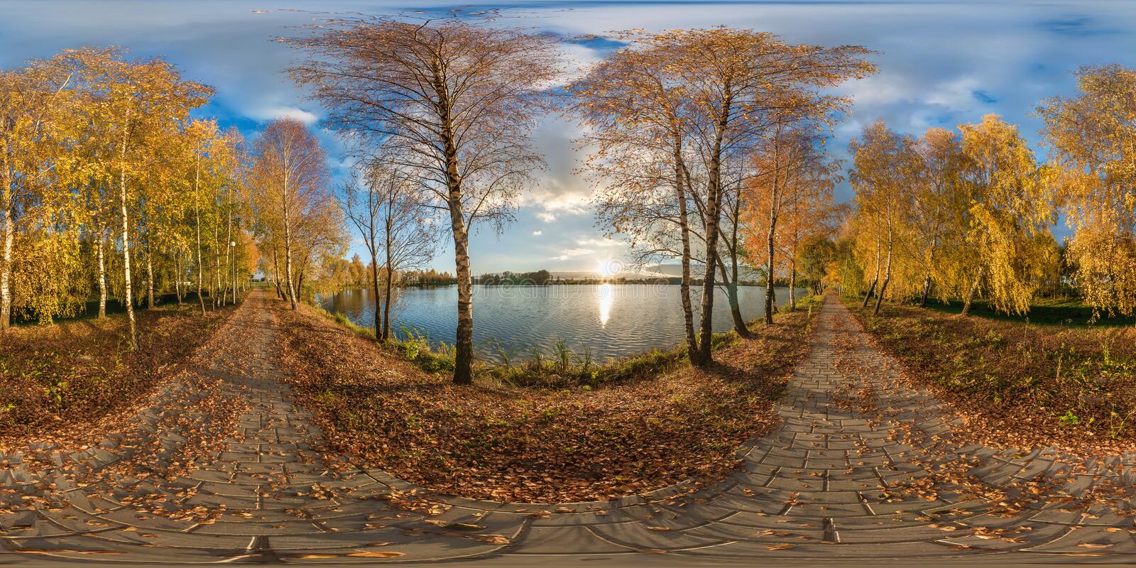 Full seamless spherical panorama 360 degrees angle view golden autumn near the shore of wide lake in sunny day. 360 panorama in royalty free stock images
