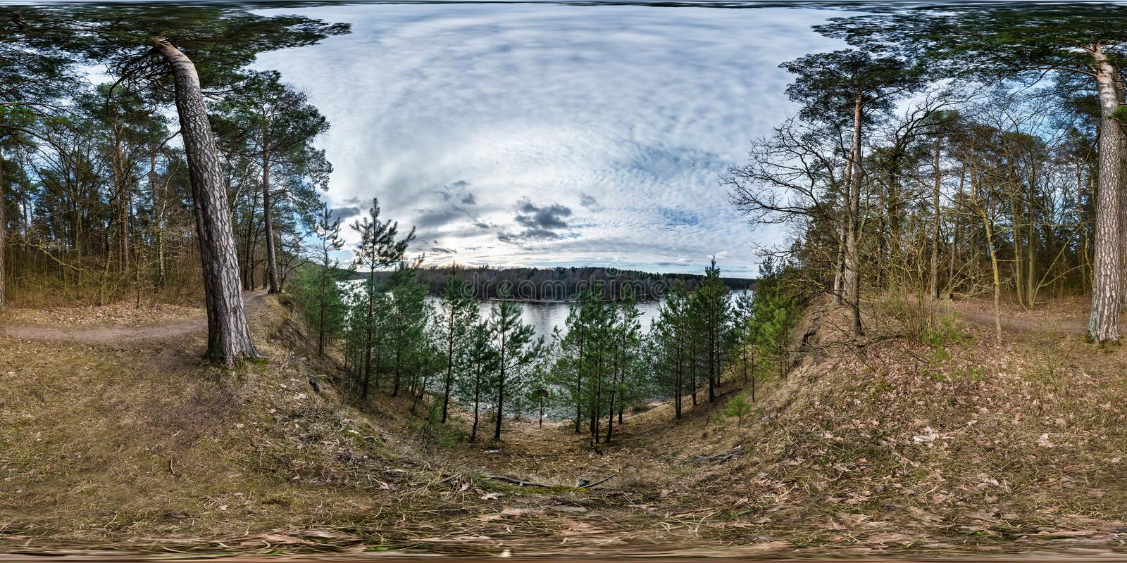 Full seamless spherical panorama 360 degrees angle view on high bank of wide river neman in evening with beautiful clouds in royalty free stock image