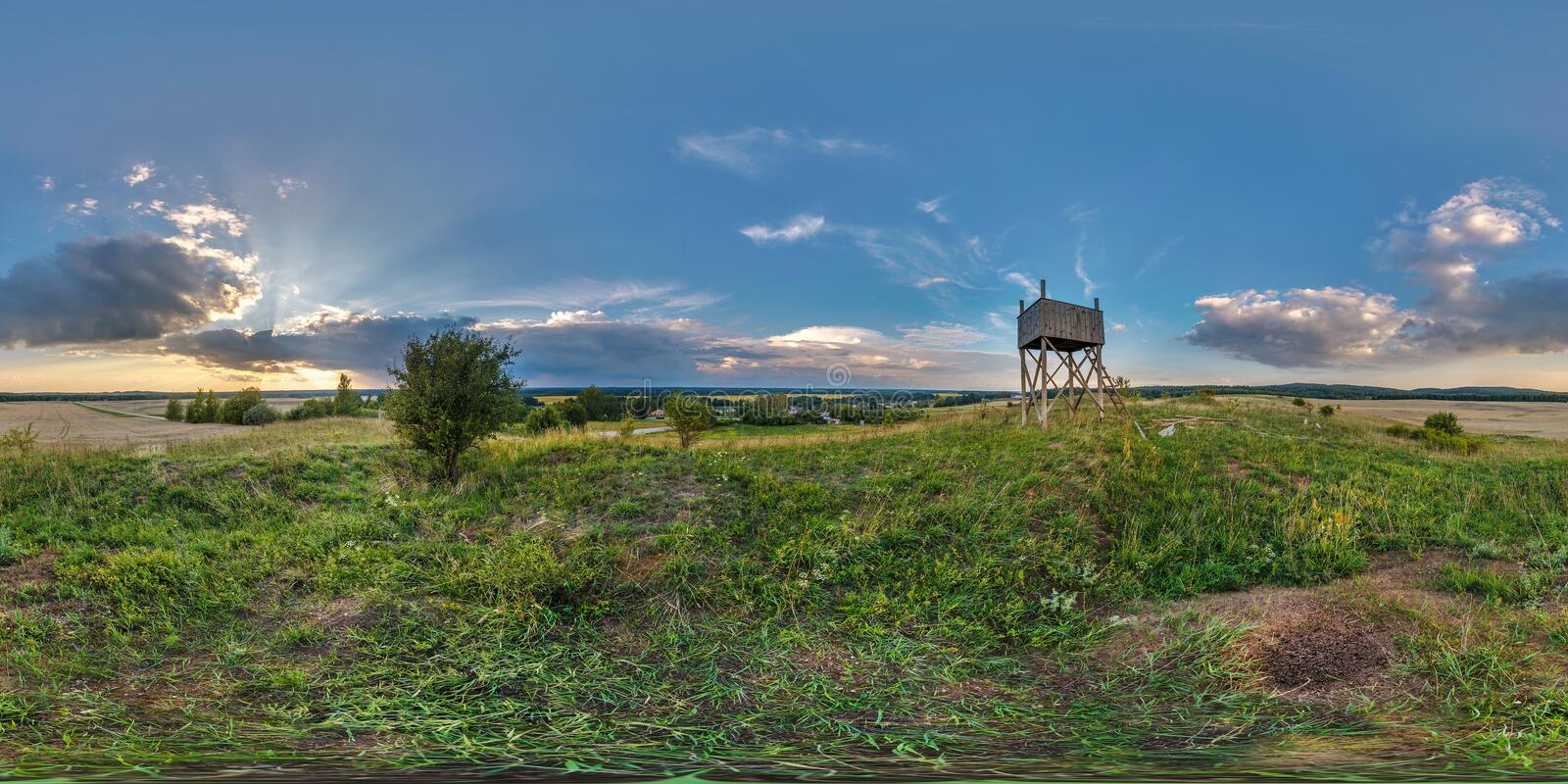 Full seamless spherical panorama 360 by 180 degrees angle view on a high visibility mountain next to the old wooden fire tower in stock photos