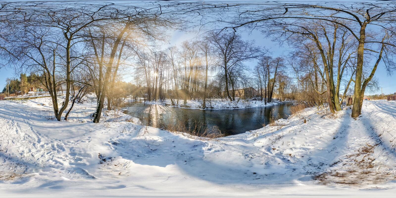 Full seamless spherical panorama 360  degrees angle view near narrow fast river in a winter sunny evening. 360 panorama in royalty free stock photos