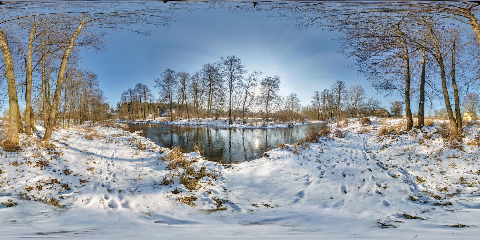 Full seamless spherical panorama 360  degrees angle view near narrow fast river in a winter sunny evening. 360 panorama in royalty free stock photo