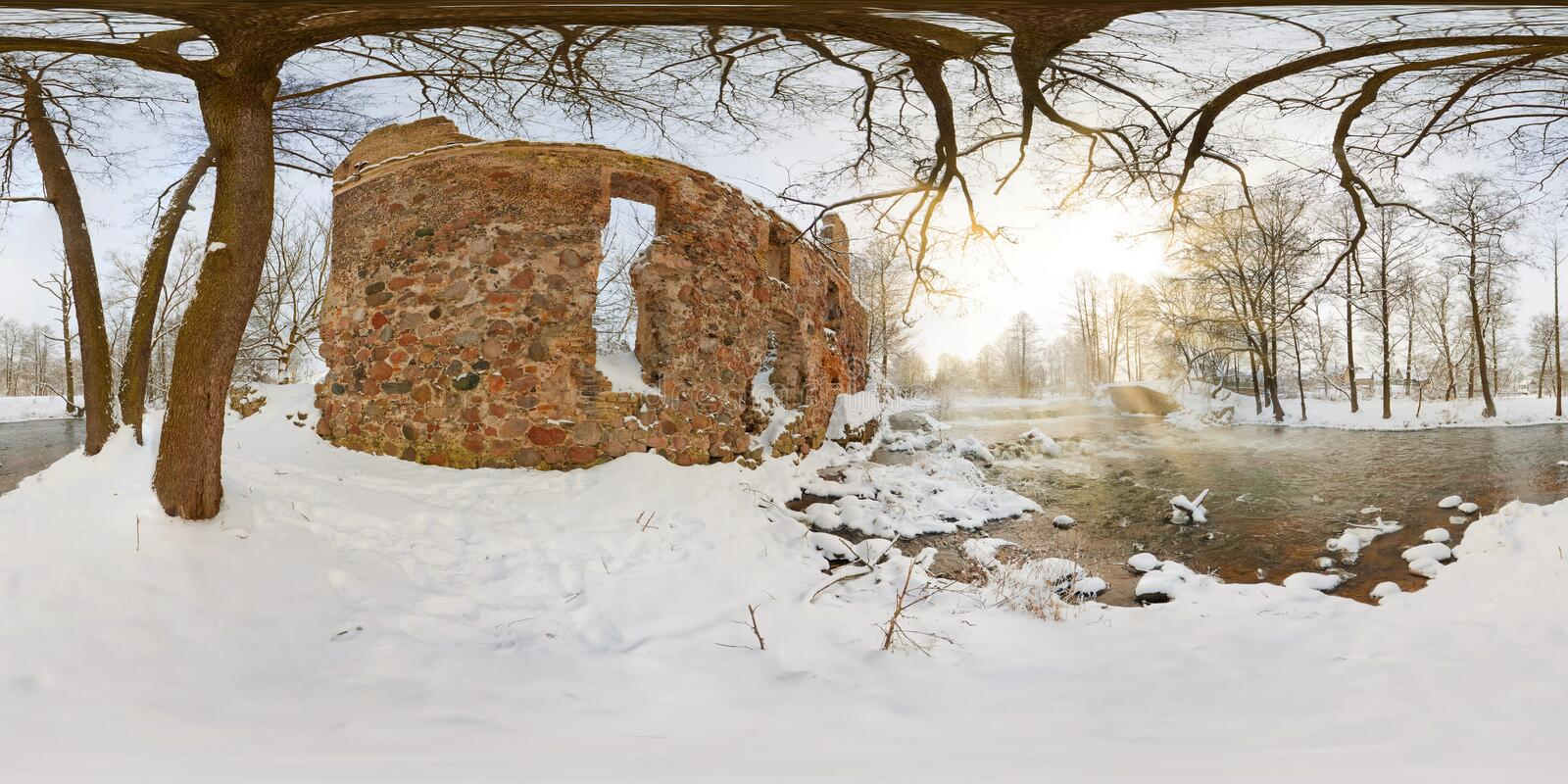Full seamless spherical panorama 360  degrees angle view near ruined water mill narrow fast river in a winter sunny evening. 360. Panorama in equirectangular royalty free stock image