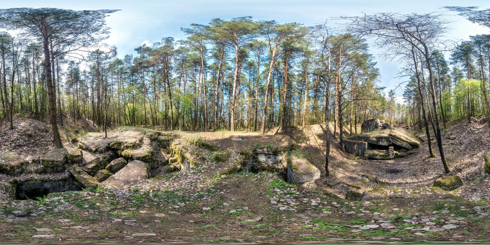Full seamless spherical panorama 360 degrees angle view ruined abandoned military fortress of the First World War in pine forest. In equirectangular projection royalty free stock images