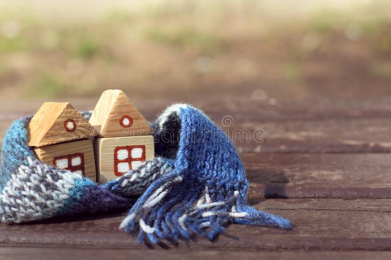 Full service discount. Two wooden houses together in a blue warming scarf stock photo