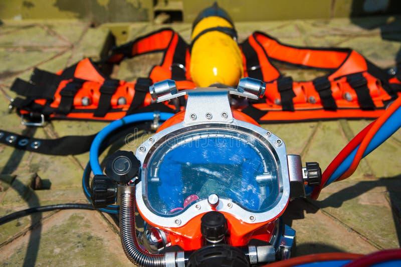 Full set of scuba diving equipment. On metal platform royalty free stock photography