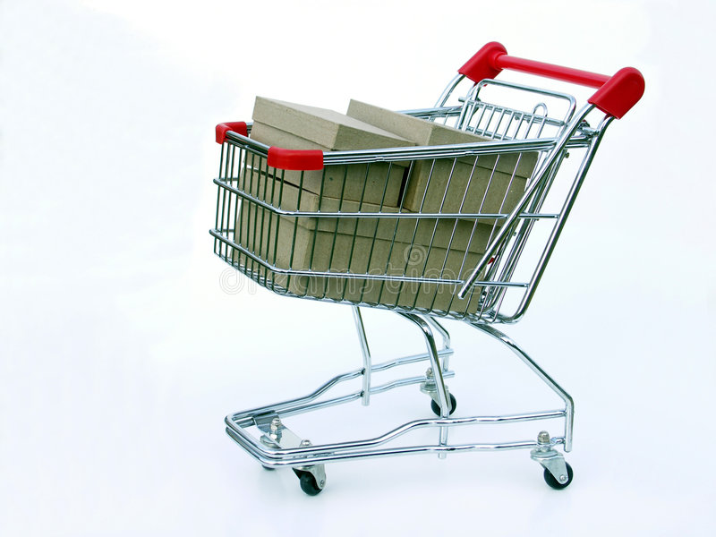 Full shopping cart. Miniature shopping cart isolated on white filled with blank boxes royalty free stock photography