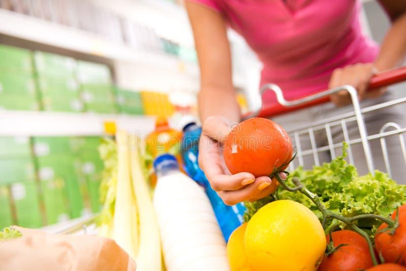Full shopping cart at supermarket royalty free stock images