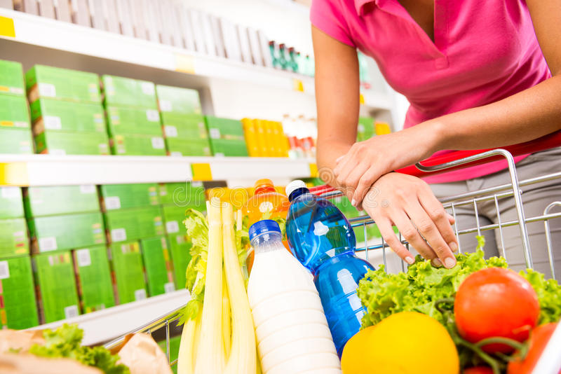 Full shopping cart at supermarket royalty free stock image