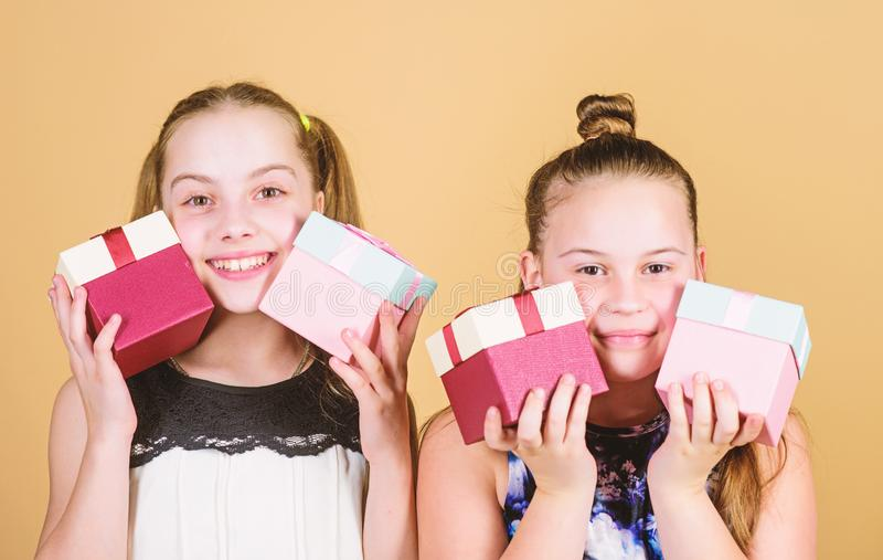 Full shopping. children. Little sisters with gift. Happy birthday. Holiday celebration. Boxing day. Christmas shopping stock photos
