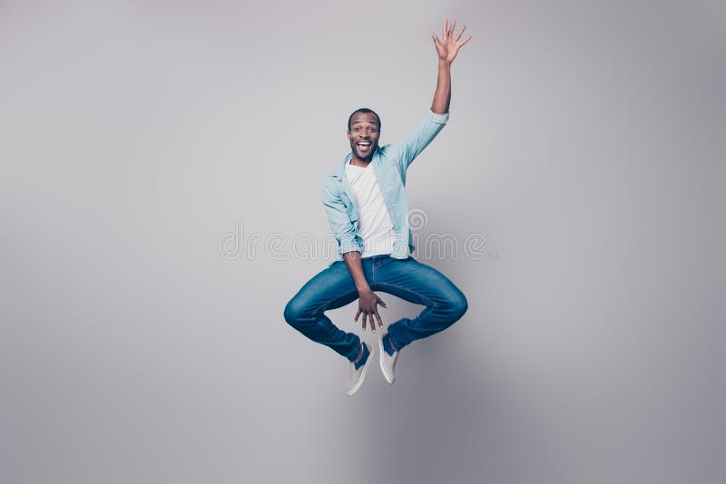 Full-size full-length portrait of cheerful handsome joyful excited delightful impressed surprised afro guy wearing casual denim j stock photo