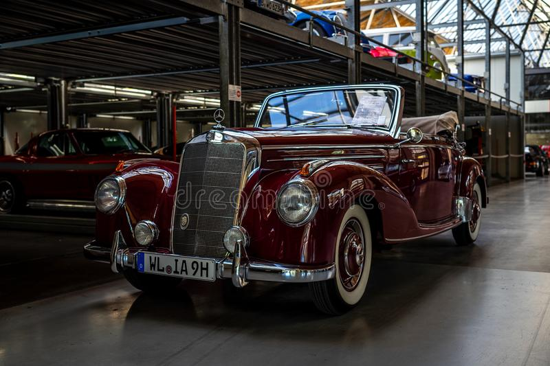 Full-size luxury car Mercedes-Benz 220 `Cabriolet A` W187, 1951. BERLIN - MAY 06, 2018: Full-size luxury car Mercedes-Benz 220 `Cabriolet A` W187, 1951 royalty free stock photography
