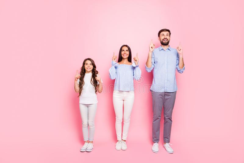 Full size photo of charming family with curly long hair wearing white t-shirt checkered blouse shirt trousers looking up royalty free stock image