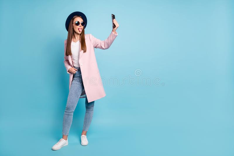 Full size photo of childish girl using her cell phone taking self photo having fun wearing eyeglasses eyewear topcoat royalty free stock image