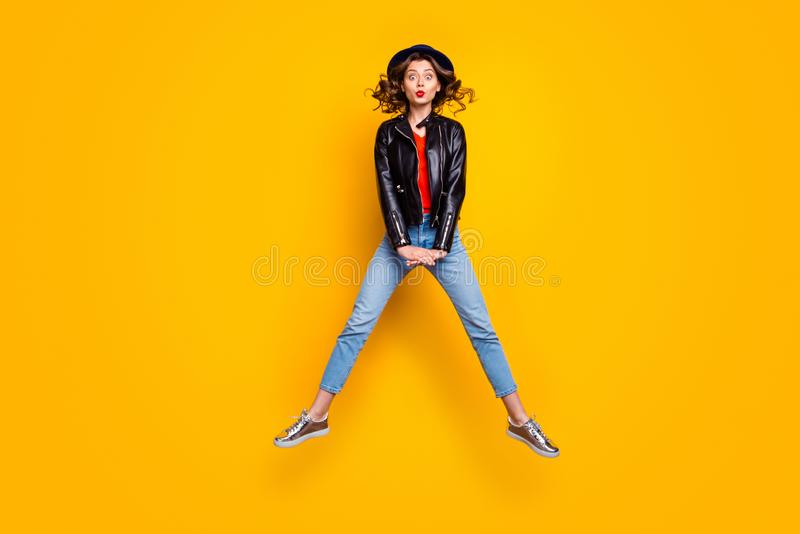 Full size photo of comic humor girl jump enjoy free time holiday wear denim jeans isolated over yellow color background royalty free stock image