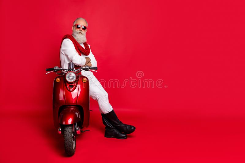 Full size photo of confident retired man with his arms crossed sit on bike wearing white pullover pants trousers boots stock images