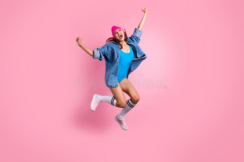 Full size photo of cute lady screaming shouting yeah raising fists wearing blue bodysuit swim suit isolated over pink stock image