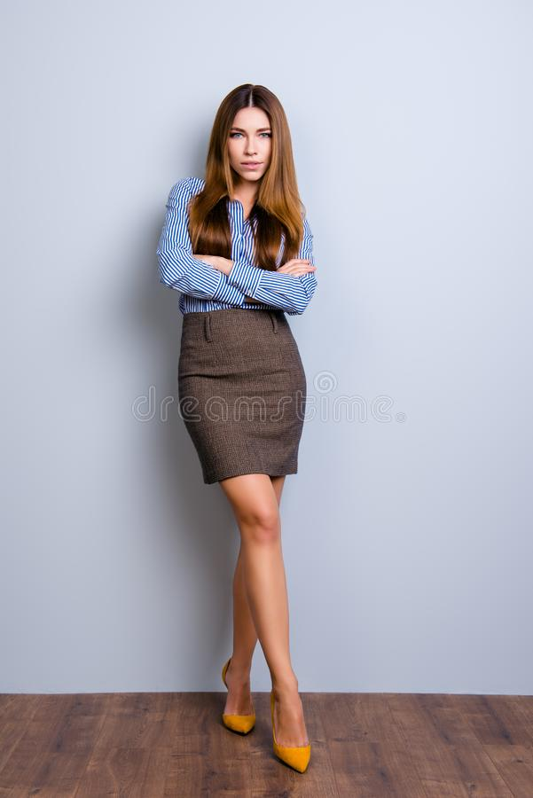 Full size photo of elegant business lady lawyer standing in flirty pose with crossed hands and legs. She looks so and. Tempting royalty free stock image