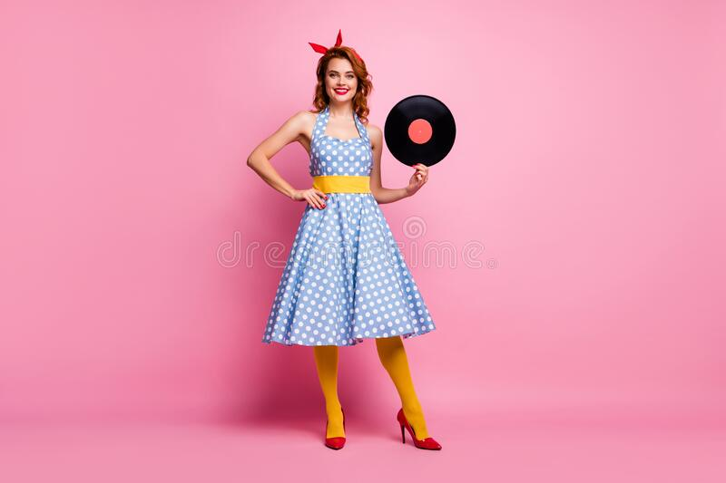 Full size photo of elegant lady old fashion vinyl cd record hands vintage retro theme party event wear dotted dress red. Full size photo of elegant lady old stock image