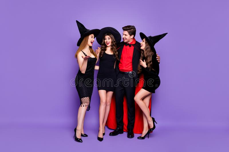 Full size photo of frightening mysterious mystical creatures conjurer hug witches communicate tell news have theme. Enchant tradition, event wear high-heels stock photography