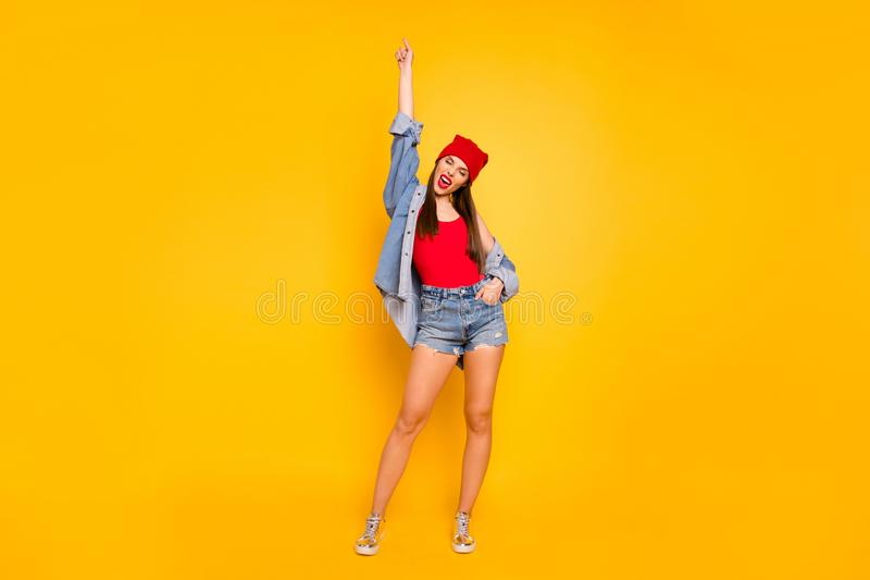 Full size photo of funky amazing lady street style hand raised up want dance wear red body tank-top denim shorts blazer stock photography