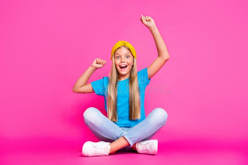 Full size photo of funky funny crazy kid sit with her legs crossed raise fists scream yeah celebrate aims goals wear royalty free stock photos