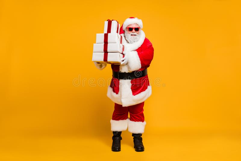 Full size photo of funny funky santa grey-hair claus in red hat headwear hold christmas packages from magic north pole royalty free stock photography