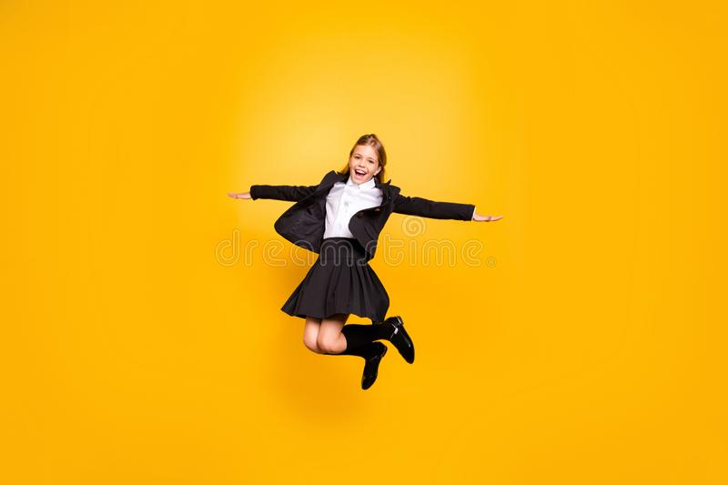 Full size photo of pretty kid raise hands laugh jump isolated over yellow background. Full size photo of pretty kid raise, hands laugh jump isolated over yellow stock photography