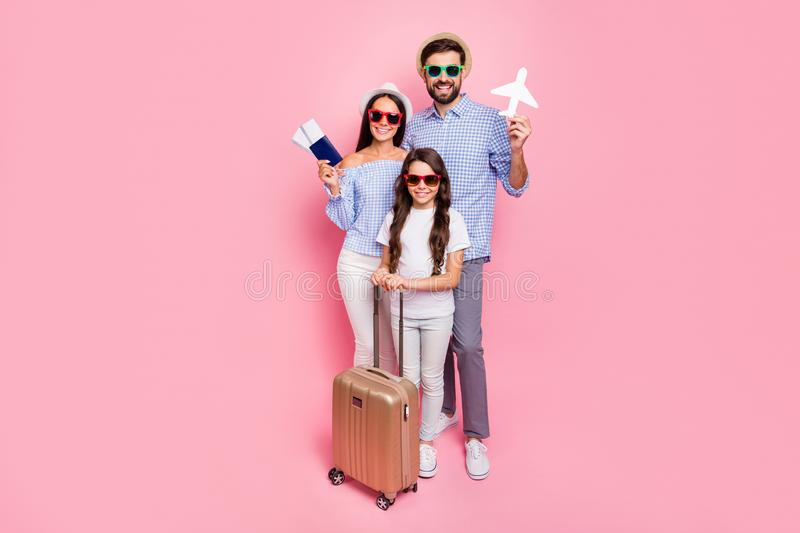 Full size photo of pretty people with brunet wavy curly hair wearing plaid clothing eyewear eyeglasses hats hold luggage stock image