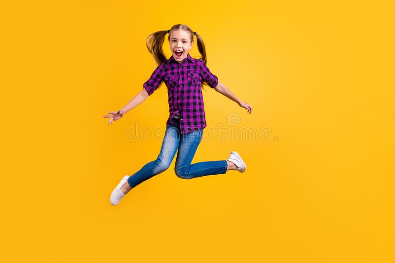 Full size photo of small pupil jump high hooray celebrate holidays wear casual checkered shirt jeans denim isolated stock photos