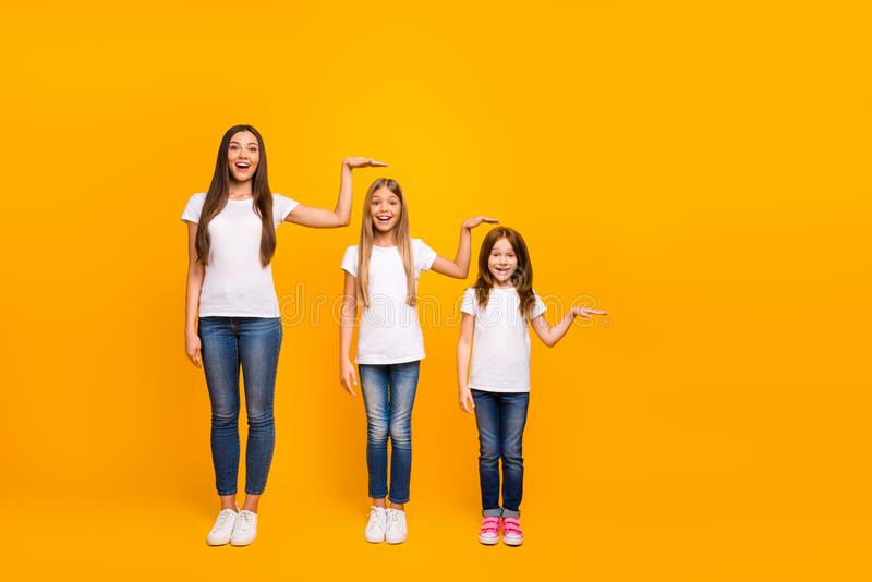 Full size photo of three sister ladies not believe such quick growing up wear casual outfit isolated yellow background royalty free stock images