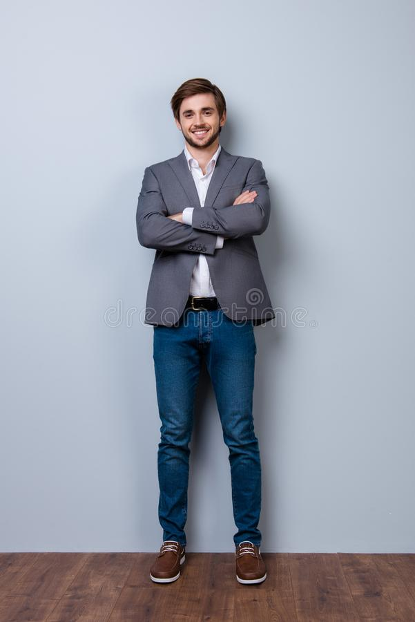 Full size portrait of happy smiling young succesful businessman, on blue background royalty free stock photography