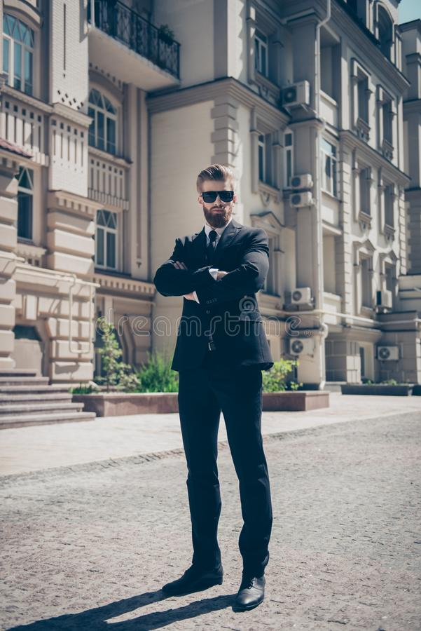Full size portrait of a harsh agent outdoors. He looks stunning royalty free stock photos