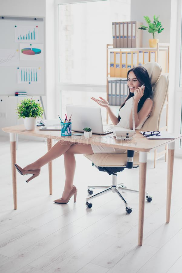Full size portrait of young successful business lady talking on royalty free stock photo