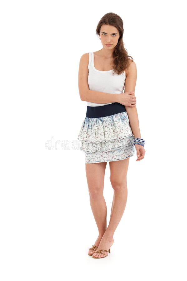 Full size portrait of young woman in summer outfit royalty free stock image