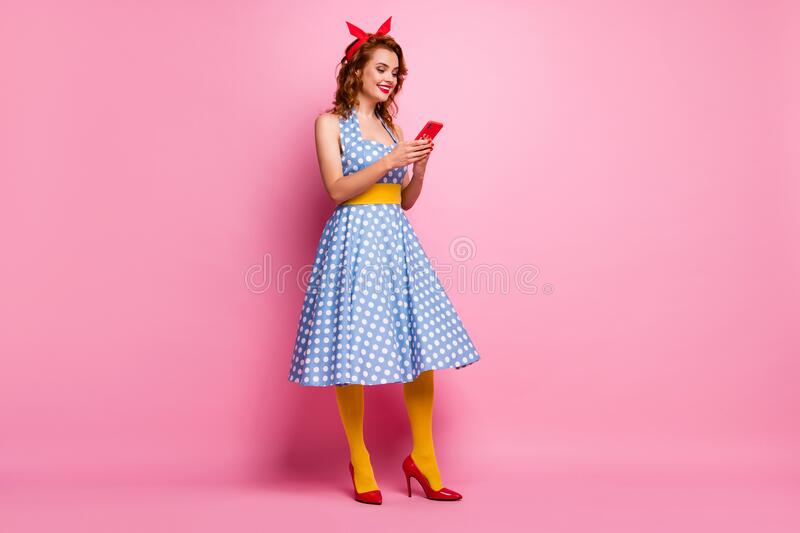 Full size profile photo of beautiful lady hold telephone hands retro theme party smart phone user wear dotted dress red. Full size profile photo of beautiful stock photos