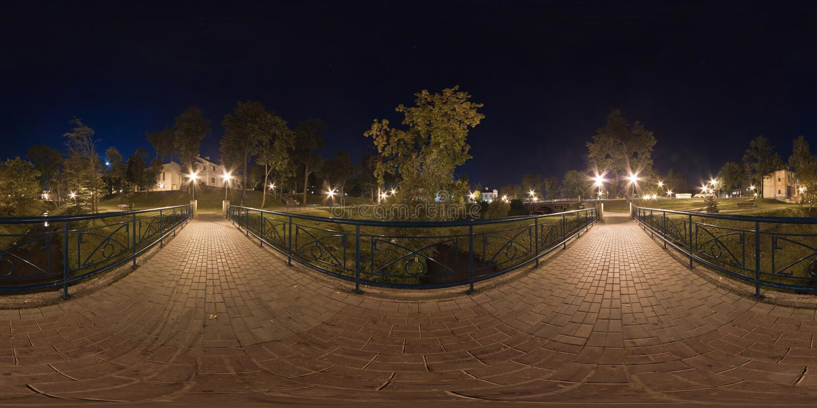 Full spherical 360 by 180 degrees seamless panorama in equirectangular equidistant projection, panorama of night park.  royalty free stock photography