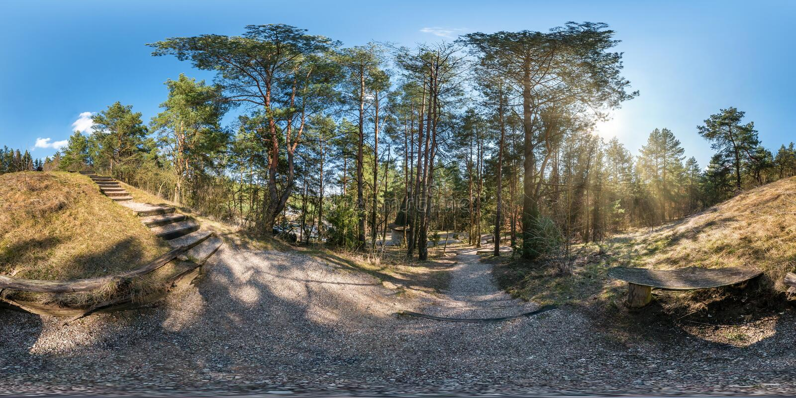 Full spherical hdri panorama 360 degrees angle view on gravel pedestrian footpath and bicycle lane path with stairs in pinery. Forest in sunny spring day in royalty free stock photos
