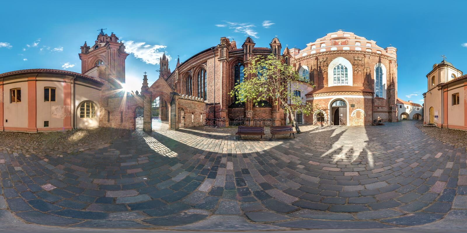 Full spherical seamless panorama 360 degrees angle in the courtyard of the old gothic church of royalty free stock photo
