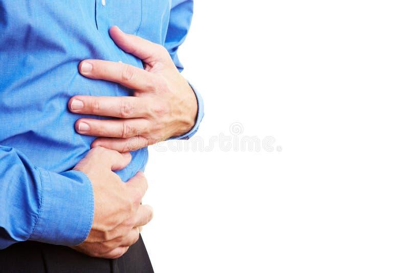 Full stomach. Senior citizen holding his sick belly stock photos