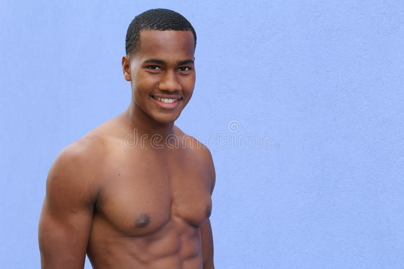 Full studio picture from a young naked African man royalty free stock image