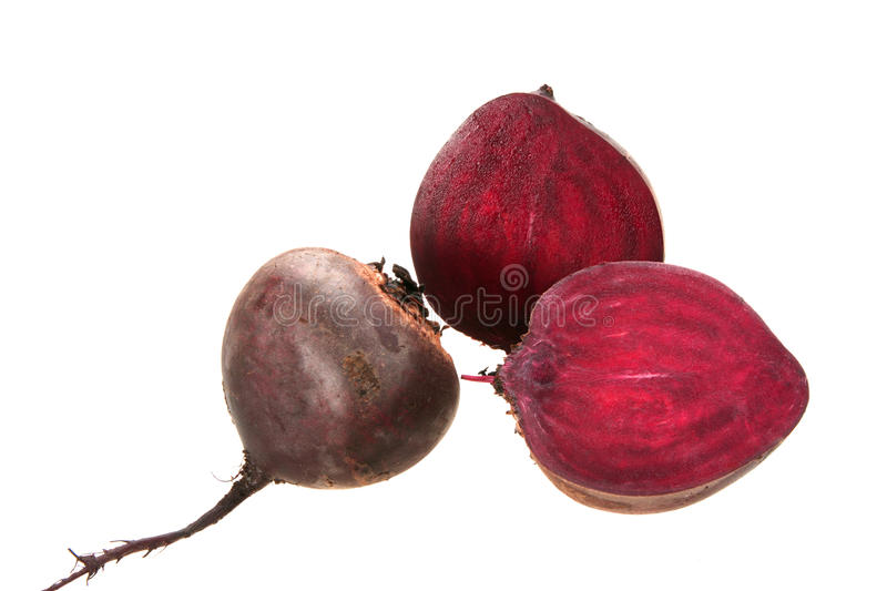 Full and two cross of beet-root. Isolated on white background. Close-up. Studio photography stock image